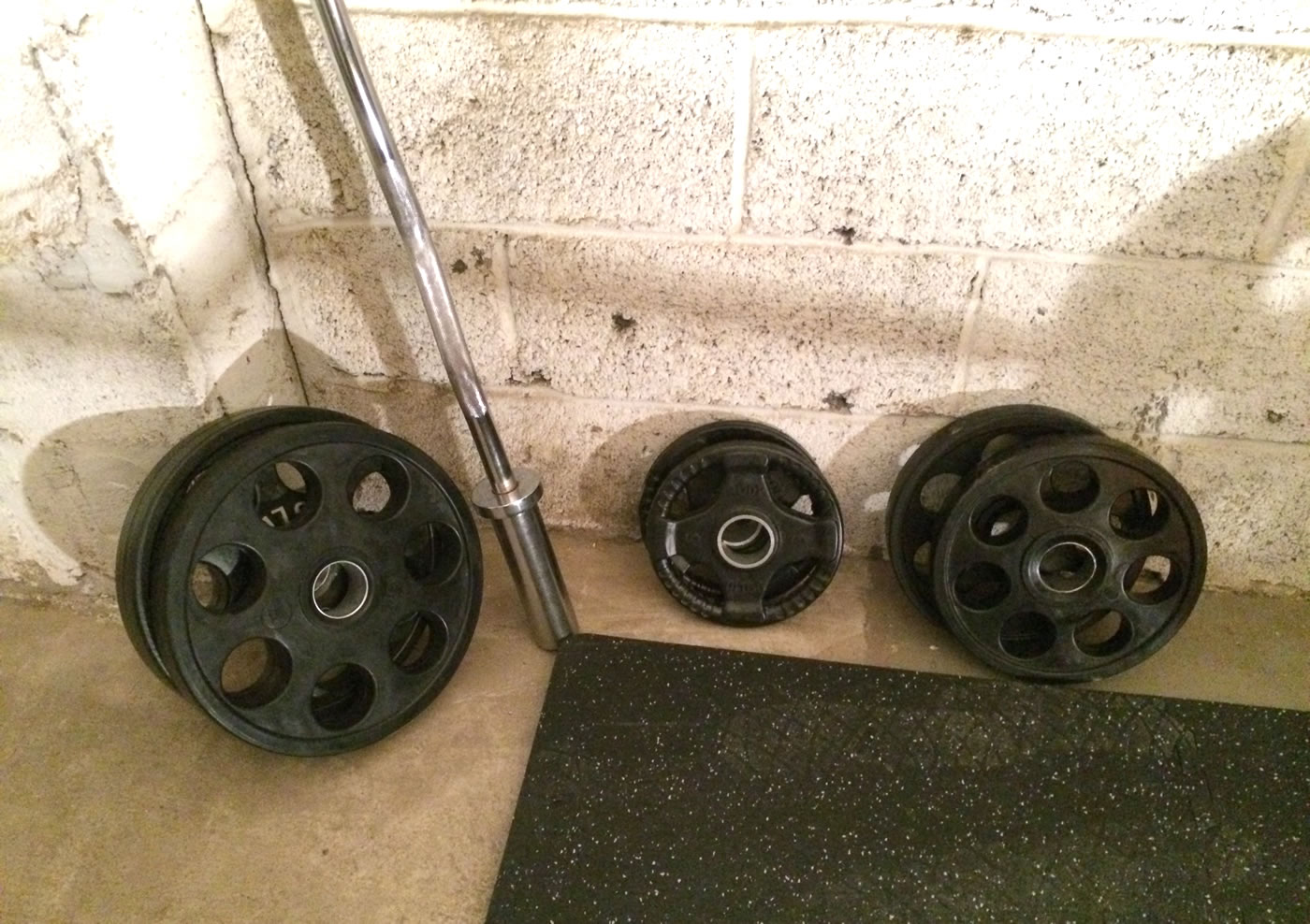 Building a home gym - hudson steel co, olympic weight plates with rubber coating.